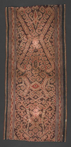 //Kain Kebat//, Iban people. Sarawak, Upper Rajah River, early 20th century, 39 x 79 cm. The unusually small size and simple rusa and tangkong motifs suggest this was a girl's bidang. From the Teo Family collection, Kuching. Photograph by D Dunlop.