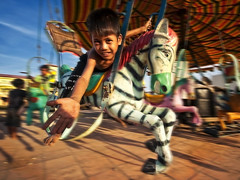 Andong Village, Phnom Penh - Amusement Park in Andong Village ? (Mio Cade) Tags: park city boy horse girl cane children fun amusement kid interesting cambodia village child poor guard social security whip environment push panning operator slum phnom penh tms andong tellmeastory evict earthasia