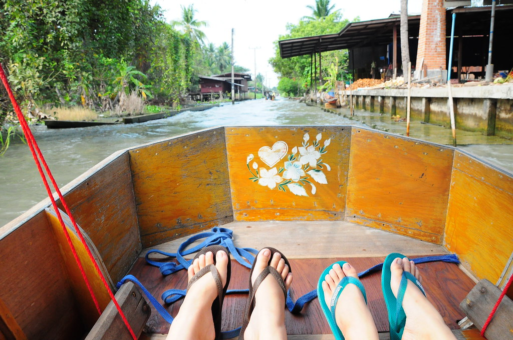 On our little sampan, along the river