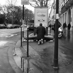 La prire du Pauvre (anw.fr) Tags: city blackandwhite bw man paris guy rain homeless prayer pray poor streetphotography pluie nb advertisement rainy rue sdf ricoh ville homme pauvre parisien pluvieux grd prire sansdomicile sansdomicilefixe affichepublicitaire