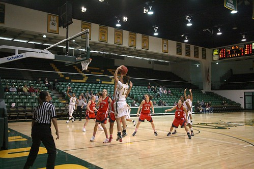 Sophomore Heidi Anton takes a contested baseline jumper over a few St.Mary's defenders. St,Mary's limited USF to 46 points.  Photo by Cass Krughoff/Foghorn