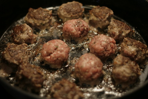 Meatballs cooking in a skillet