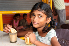 Girl eating chai and pau -Terre d'Espoir (Pondspider) Tags: poverty india girl children child goa enfants enfant pau chai colva linde pauvret migrantworkers anneroberts annecattrell terredespoir janinegaiddon pondspider charitfranaise