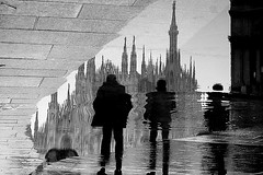 Three (Donato Buccella / sibemolle) Tags: street blackandwhite bw italy milan reflection rain milano massiveattack duomo puddles pozzanghera canon400d rainingdays sibemolle fotografiastradale losolasolitapozzangherachepalle