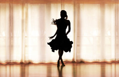 Dancer (.Bradi.) Tags: light motion reflection window girl silhouette hair for is dance movement warm d dancer skirt alsojustfoundoutweregoingtoseealiceinwonderlandtonight