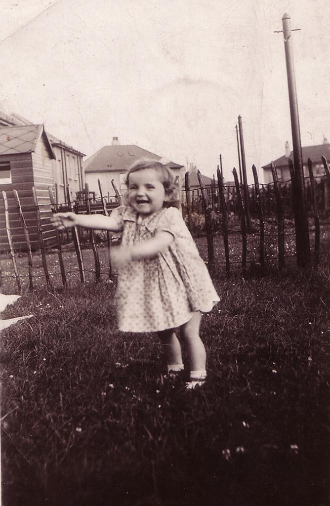 Peggy McLean Lauder in garden, 1940.