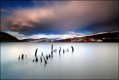 Longy - Loch Tay (angus clyne) Tags: old uk winter wild mountain lake cold art beach nature wet water weather forest river landscape island march scotland pier boat interesting europe long exposure flat post natural wind britain jetty perthshire deep surreal scottish wave bank calm hills tay photograph shore loch nothing wreck banks flikcr lightdark canoncamera explored leefilters colorphotoaward canoneos5dmarkii angusclyne northeastwestcentralscotland crazyrainsnowhailstormcloudcloudycloudssky