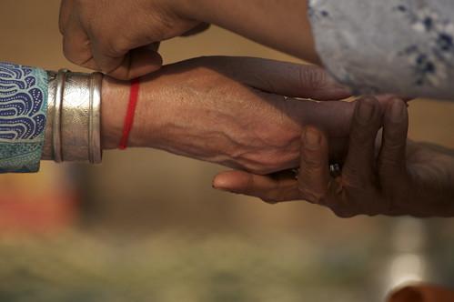 A Buddhist Nun Ties A String Of Faith