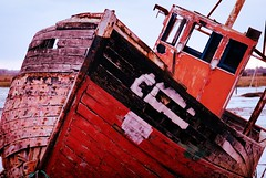 Red ruined boat at West Mersea (domturner) Tags: wood red boat peeling paint ship painted ruin shipwreck rotten wreck wrecked westmersea