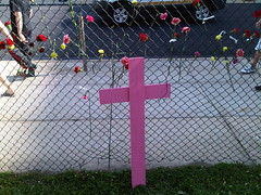 Flowers and pink cross representing the Juárez victims