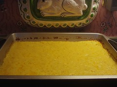 a pan of baked cheese grits using beer cheese