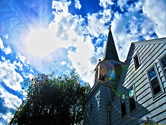 The Chapel. (Adam Brown!) Tags: desktop old blue b sun white color church rotting minnesota clouds town woods skies cross gorgeous north chapel steeple flare mn brainerd northwoods btown 56401 adnoctum