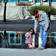 (StephenZacharias) Tags: orange canada water reflections keys puddle spring dad winnipeg child dress candid father daughter manitoba jeans relationship canopy redshoes tender striped theforks tiptoe dps tapping 105mm thisorthat 8820