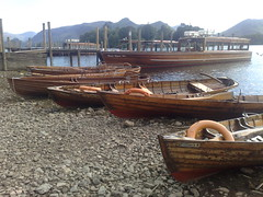 Derwentwater Boats and Catbells, Keswick, Cumbria, Lake District (woodytyke) Tags: peak landscape water scenery woodytyke uk trees walking english england district british britain derwentwater boats catbells rowing boat fells shingle beach wooden clinker built jetty landing satge island pleasure hiking posts cumbria moored mooring lakes keswick launch lifebuoy lakeland visitor tourism north west touring great united kingdom westmorland cumberland county photo photography isles borrowdale stephen woodcock photograph camera foto best picture composition digital phone colour flickr image photographer light