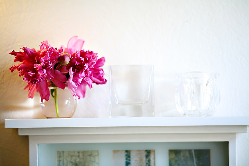 peonies on a shelf