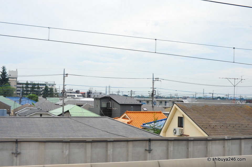 Along the way I took some photos from the train window. When you are close in to Tokyo, you mainly get pictures of house roofs alongside the tracks.