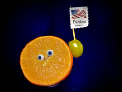 Happy 4th of July (mallen...) Tags: 4thofjuly orange blue eyes happy face lomo fruit forever freedom mt stamp flag blueplatespecial led