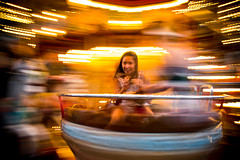 Girl enjoying the pleasure of speed on a carousel in Avignon, Southern France. (Phototravelography) Tags: avignon france provence caroussel fast fun girl gold holidays lady motion movement speed vacation fccmotion merrygoround roundabout holiday flickr summervacations flickrfriday ngc