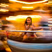 Girl enjoying the pleasure of speed on a carousel in Avignon, Southern France.