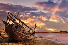 Retired boat ! (Saad Al-Enezi) Tags: wood sunset sea sky sun beach clouds boat wooden sand nikon skies mosque boom beached kuwait dhows retired derelict doha d300 inthemood aldoha gluf arabiangulfsea saadalenzi