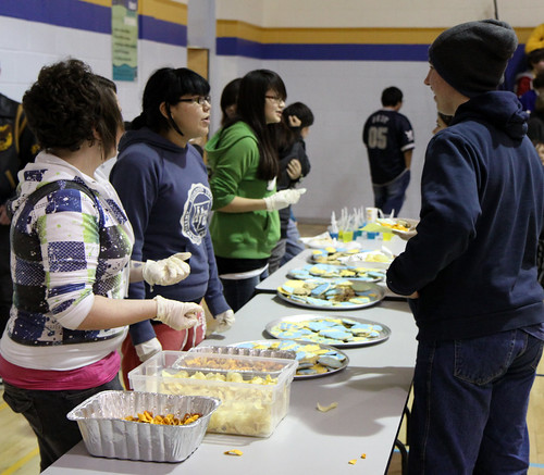 Grade 8 Students check out the tasty treats provided by the Food and Nutrition class.