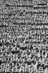 Sopa de letras (sjpadron) Tags: barcelona espaa blancoynegro architecture nikon text letters bn gaudi lasagradafamilia catalua catalan letras texto curvas antonigaudi mosaicos 5photosaday templeexpiatoridelasagradafamlia d700 temploexpiatoriodelasagradafamilia nikond700 anquitectura sergiopadron
