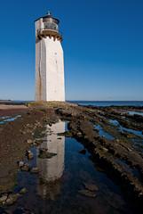 Southerness Lighthouse (Nick Landells) Tags: lighthouse reflection dumfriesandgalloway southerness dumfriesshire solwayfirth tokina1224mm d80 landscapesshotinp