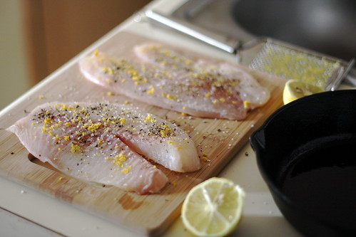 lemon and fresh-ground black pepper on fish