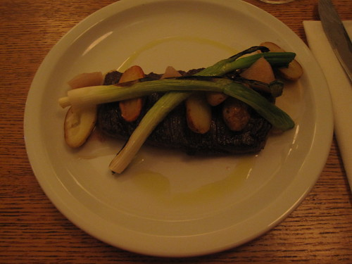 Horse steak with pear pickles, roasted potatoes and green onion