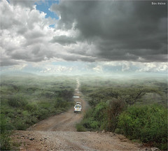 New Horizons (Ben Heine) Tags: africa road street camera trees wild sky mountains art tourism nature rain weather clouds composition truck lens landscape photography vanishingpoint nikon rocks poem dof jeep d70 cloudy kenya pov earth path stones pierre horizon perspective creative dream manipulation hills adventure safari route ciel camion montage van conceptual discovery bushes pound depth chemin daybreak sfumato meteo montagnes dcouverte jurassicpark afrique sauvage mattepainting savana softcolors savane marcage petersquinn mywinners benheine infotheartisterycom