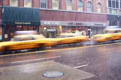 Rain Rain Go Away (Houry Photography -on/off) Tags: street windows rain yellow reflections photography cab manhole stores cabs bldgs houry canon50d
