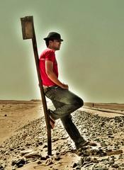 Waiting in the Sun (LдįŠ) Tags: red hat stone way lumix sand desert egypt rail panasonic oasis fz8