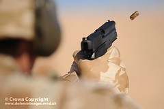 Soldier Fires Sig Sauer Pistol in Jordan (Defence Images) Tags: uk training army mod gun desert exercise unitedkingdom britain military case jordan equipment weapon pistol british bullet express handgun defense defence ammunition firing 9mm cartridge firearm sidearm ministryofdefence sigsauer smallarms ejecting