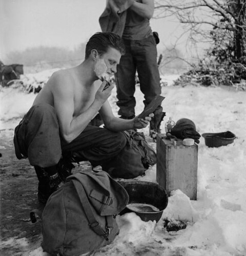 Soldier shaving at outside cold weather.