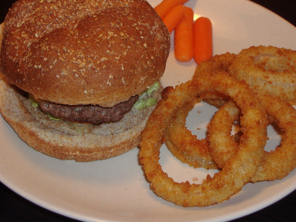 hamburger with onion rings. (and carrots.)