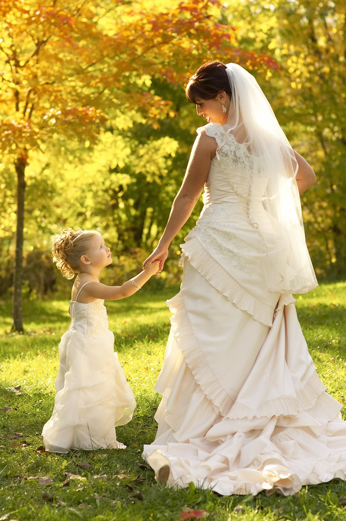 Bride and flower girl in fall colors