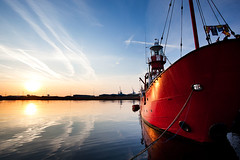 A new day begins ... (Rob Overcash Photography) Tags: uk morning blue red sky orange color reflection water wales sunrise canon dawn saturated ship cardiffbay robotography internationalgeographic 5dmkii robovercashphotography