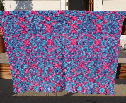 Handmade pink and blue baby blanket knit in a basketweave pattern