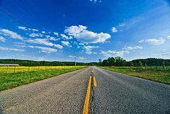Life is a Highway (outsideshot) Tags: road blue sky green yellow clouds vanishingpoint highway tokina1116