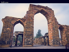 Standing Tall (Nikhil.Hirurkar) Tags: door sky brown india broken architecture afternoon delhi palace pillars qutub height remnants qutubminar asi mogul mughal kutubminar bigdoors