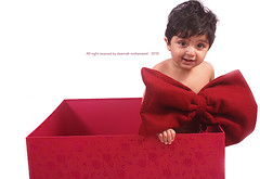 Take Your Gift =p (Deemah Al-Shaaya - twitter.com/#!/deemah_sh) Tags: camera red white kids canon children photo kid child pics pic your gift take 2010 dema   deema      450d deemah     d450          doeem