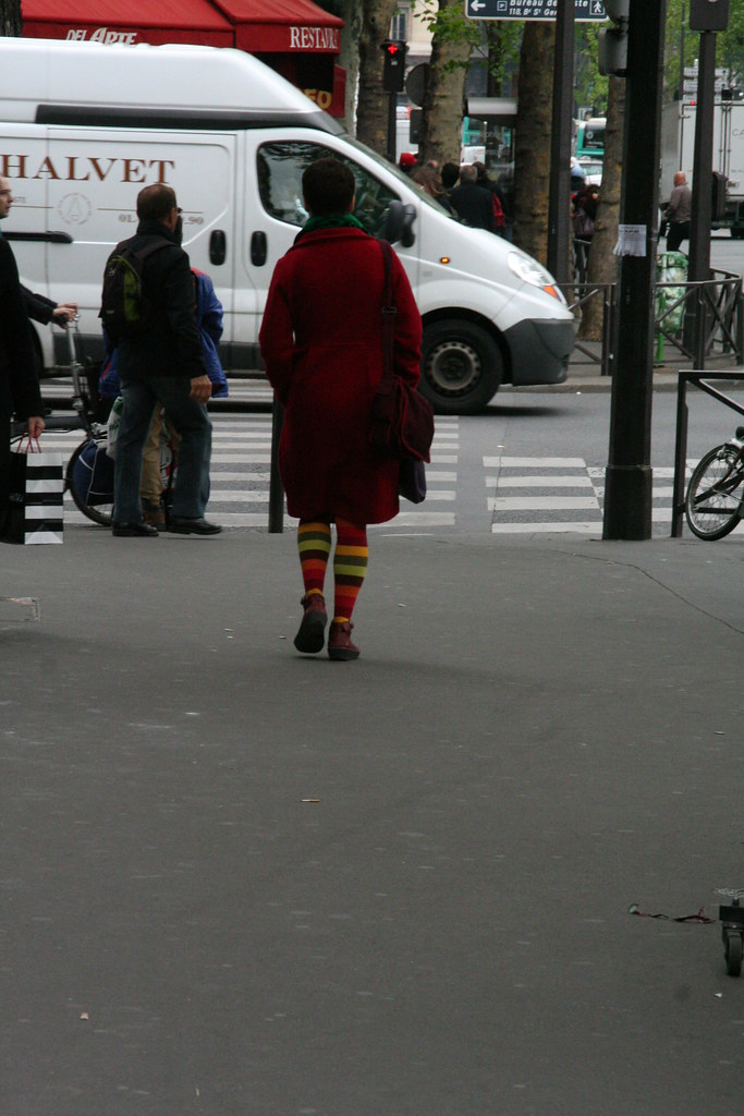 21. French style - woman with bright striped tights and red coat