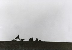 (RebeccaStone) Tags: dog men film beach landscape blackwhite ancient afternoon pebbles tent photo1