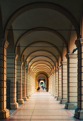Bologna (Philipp Klinger Photography) Tags: trip italien light shadow vacation people italy holiday lines yellow architecture point lumix vanishingpoint europa europe italia floor arches panasonic emilia bologna arcades vanishing philipp colonnade p