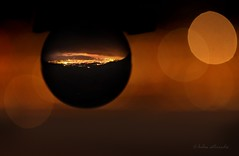hot spot (helen sotiriadis) Tags: city glass night canon ball landscape lights cityscape dof crystal bokeh athens depthoffield greece sphere refraction penteli canonef100mmf28macrousm pendeli ymittos canoneos40d