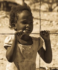 Peeping (biancapreusker) Tags: africa portrait girl monochrome namibia 2010 anawesomeshot canon450d thechallengefactory captainschoice dex4 gaingu