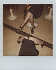 a game of legs (cHr1st1an S images) Tags: city girls italy woman black color sexy film feet colors girl square polaroid hands shoes flickr legs chairs milano flash skirt line diagonal squareformat heels planetarium planetary expired polaroid600 expiredfilm instantfilm expiredpolaroid chr1st1ans planetariodimilano oneeveninginmilan christiansorrentino
