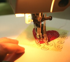 sewing the hearts onto the card