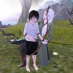Use my bow for now penneth. (Mordred Avindar) Tags: elf lady woman lesson child dúnedain boy bow childhood arrow shoot tree tolkien lotr kid roleplay rustic ranger medieval avatar secondlife sl light day borrow training childavatar sindar grass green water woods waif cute character costume explore little lake sun river bright family fantasy forest adventure aunt elven nature man human hunter hunting grow serious kin kind kindness archery friend tweenster noldor estel middleearth thehobbit thelordoftherings rivendell friendship archer hobbiton tunic mesh practice elves innocent