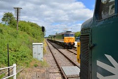 47828 passes the British Gypsumunloading facility as it approaches Rushcliffe Halt, with a service to Loughborough. 45060 is waiting in the station for the road. Great Central Railway North Diesel Gala. 02 07 2017 (pnb511) Tags: gcrn greatcentralrailwaynorth class47 trains track loco locos locomotive locomotives platform station sky clouds brush4 diesel class45 peak 45060